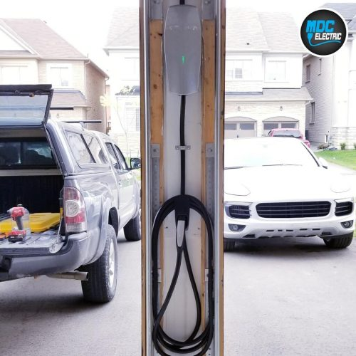 Tesla charger between garage doors by MDC Electric