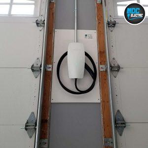 Tesla generation 3 wall connector between garage doors